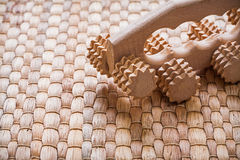 Wooden relaxing massager on wicker background Royalty Free Stock Images