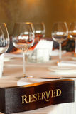 Wooden reserved plate on restaurant table Royalty Free Stock Photo
