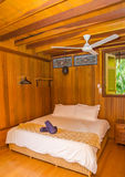 Wooden Resort Room with Bed Royalty Free Stock Image