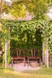Wooden rest chairs in botanic garden. Phuket, Thailand Stock Image