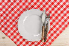 Wooden Restaurant Table with Checkered Red Tablecloth Royalty Free Stock Image