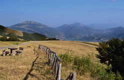 A wooden resting place on a narrow road bordering the mountains. Of central Italy royalty free stock photography