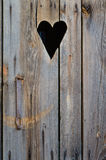 Wooden restroom door with heart shape Stock Photos