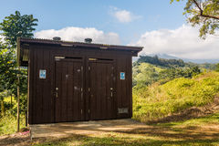 Wooden restroom in forest Royalty Free Stock Photography