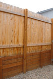 Wooden Retaining Wall with fence above - New. New Wooden Retaining Wall with fence above and gravel around the retaining wall. Retaining wall from one persons Stock Photo