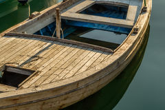 Wooden retro boat on a water Royalty Free Stock Images