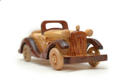 Wooden retro car model. Isolated on white royalty free stock photos