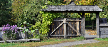 Wooden retro style gate to a house Stock Image