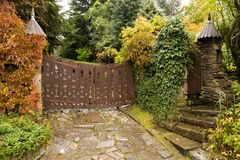 Wooden retro style gate to house Stock Image