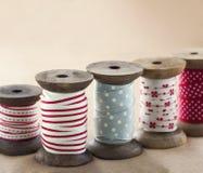 Wooden ribbon spools Stock Photos