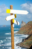 Wooden road sign with empty boards Stock Image