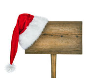 Wooden road sign with Santa  hat Stock Photography