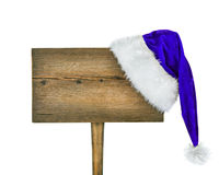 Wooden road sign with Santa  hat. Isolated on a white background Stock Images
