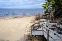 Wooden road to sandy beach of Saulkrasti town in Latvia Stock Images