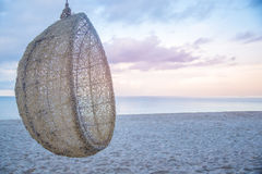 Wooden and robe cradle at sea for relax.  Royalty Free Stock Images