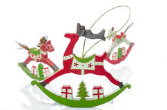 Wooden rocking animal Christmas decorations. Studio shot of traditional retro style wooden rocking horse and rocking reindeer Christmas decorations, in shades of Stock Photo