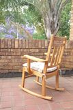 Wooden rocking chair on the balcony Royalty Free Stock Photo