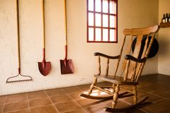 Wooden rocking chair in a farmer house royalty free stock photo
