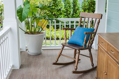 Wooden rocking chair on front porch. With pillow Stock Image