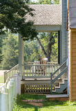Wooden rocking chair on porch of old house Stock Photo