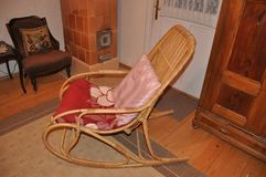 Wooden rocking chair in rural retro simple vintage interior royalty free stock photography