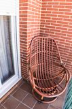 Wooden rocking chair on terrace royalty free stock photos