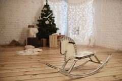 Wooden rocking horse in decorated by Christmas to room Royalty Free Stock Photo