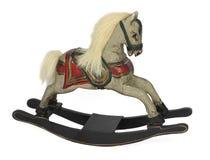 Wooden rocking horse isolated on white background. Hand carved wooden rocking horse with painted saddle isolated on white background Royalty Free Stock Image