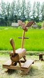 Wooden rocking horse. Placed beside the field Royalty Free Stock Photography