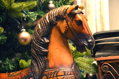 A wooden rocking horse under the Christmas tree royalty free stock photos