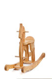 Wooden rocking horse on white with copy space Royalty Free Stock Photos