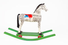 Wooden rocking horse on a whiter background Stock Photo