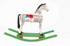 Wooden rocking horse on a whiter background. Children's wooden rocking horse isolated on a white background Stock Photo