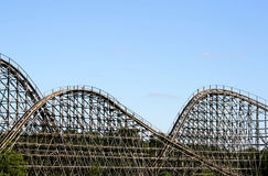 Wooden roller coaster. Against blue sky Royalty Free Stock Photos