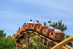 A wooden roller coaster for children Tami-Tami in the park Port Aventura in city Salou, Catalonia, Spain. royalty free stock photos