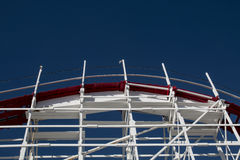 Wooden Roller Coaster. High point of a wooden roller coaster track against a clear blue sky Stock Images