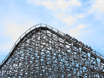 Wooden roller coaster train upwards Royalty Free Stock Photos