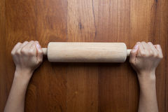Wooden roller,female cook rolling dough with rolling-pin. Closeu Royalty Free Stock Images
