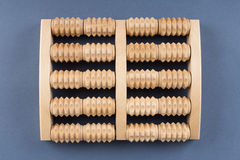 Wooden roller massage tool  for feet Stock Photo