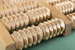 Wooden roller massage tool  for feet Royalty Free Stock Images