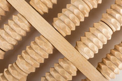 Wooden roller massage tool  for feet Royalty Free Stock Photo