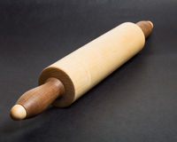 Wooden rolling pin on bakery table Royalty Free Stock Photos