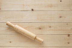 Wooden rolling pin on brown table Royalty Free Stock Images