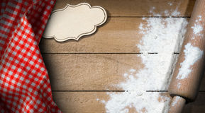 Wooden Rolling Pin and Flour on a Table Royalty Free Stock Image