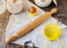 Wooden rolling pin. And food ingredients for cooking a cake at home Royalty Free Stock Photography