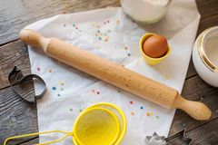 Wooden rolling pin. And food ingredients for cooking a cake at home Royalty Free Stock Image