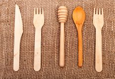 Wooden rolling-pin, fork, knife and spoon Royalty Free Stock Photography