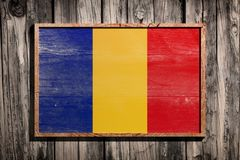 Wooden Romania flag. 3d rendering of Romania flag on a wooden frame over a planks wall Stock Photo