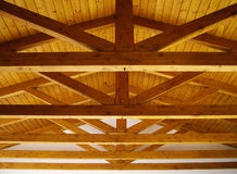 Wooden roof beams. Architectural details showing supporting wooden beams underneath roof stock photography