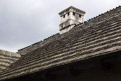 Wooden roof with chimney an old rural house royalty free stock image